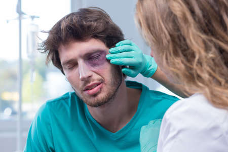 Portrait of male patient with black eye