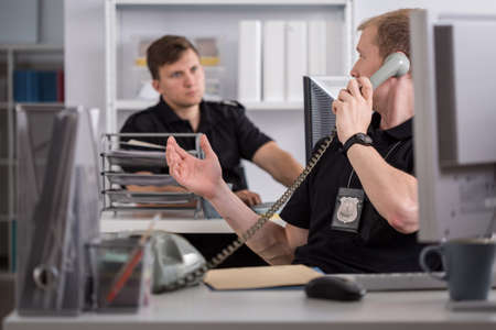 Image of policeman talking on the phone Stock Photo