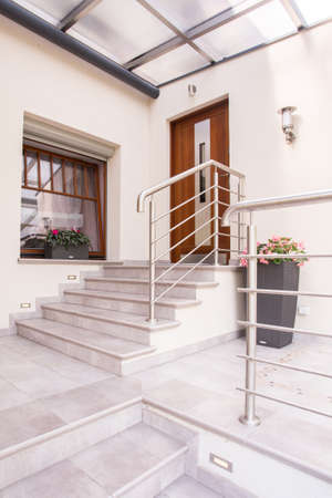 balcony door: Vertical view of entrance to modern house Stock Photo