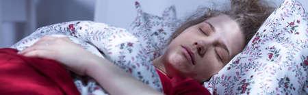 friendless: Panorama of woman lying in bed sleeping after long crying Stock Photo