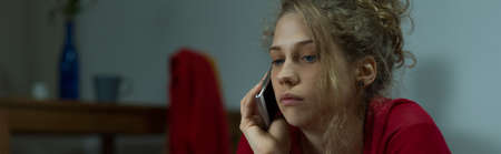 tearful: Panorama of young female trying to fight loneliness