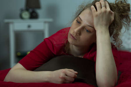 mentally: Horiznotal view of a mentally broken woman feeling lonely Stock Photo