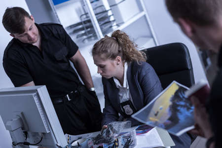 detective agency: Image of woman working in the police Stock Photo