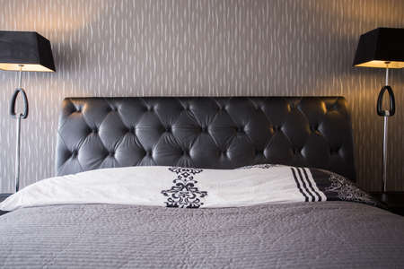 headrest: Close-up of comfortable bed with leather headrest Stock Photo