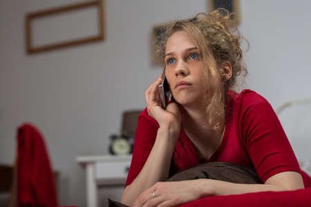 friendless: Panoramic photo of young alone woman calling her mother