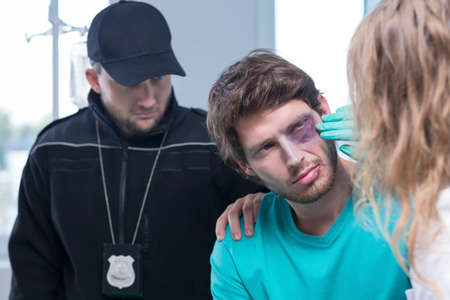delinquent: Horizontal view of young criminal in hospital Stock Photo