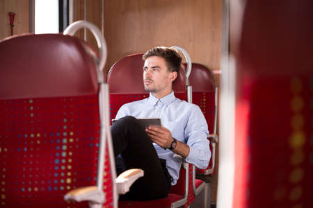 buses: Photo of businessman leading healthy lifestyle using pubblic transport