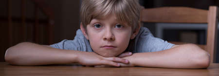 Panorama of young boy in pensive mood alone Stock Photo
