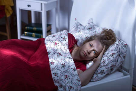 unable: Young woman living alone being unable to fall asleep