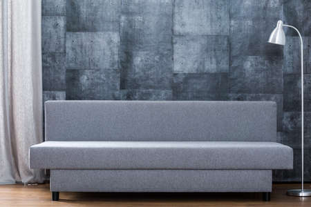 living room wall: Sofa and concrete wall background in living room Stock Photo