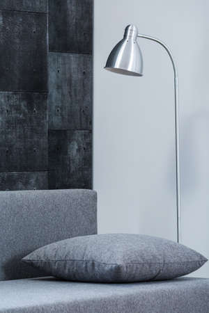 floor lamp: Room with concrete wall and silver floor lamp Stock Photo