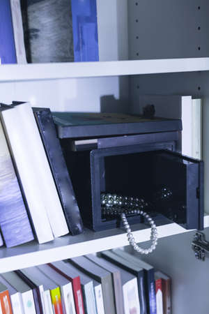 safe house: Image of open safe with expensive jewellery