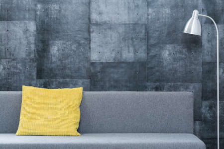 couch: Yellow pillow on couch in loft arrangement design