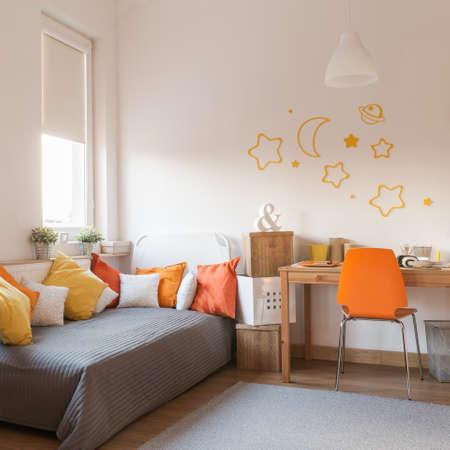 homelike: Yellow and orange accessories in modern teen room