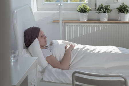 woman profile: Profile of a woman lying in a hospital bed