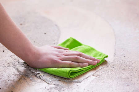 wood floor: Woman wiping dirty wooden floor with micorofibre cloth