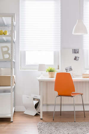 home furniture: Close-up of orange chair in teen room