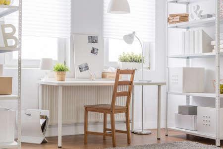 muebles de madera: White furniture and wooden chair - minimalist teen room Foto de archivo