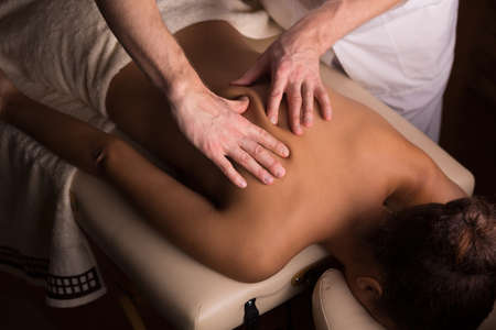 masseur: Close-up of masseur moving tissue during massage