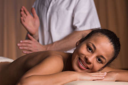 physiotherapists: Young happy woman at physiotherapists office on medicinal massage