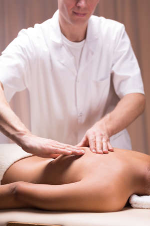 relief: Physical therapist doing relaxing massage on spine Stock Photo