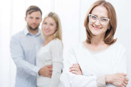 marital: Picture of psychologist and pair after successful marital therapy