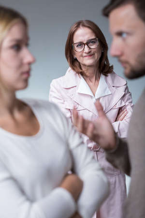 intrusive: Image of intrusive and jealous mother-in-law Stock Photo