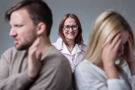 intrusive: Photo of marital conflict and mean and intrusive mother