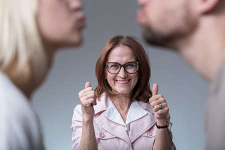 motherly: Photo of good mother-in-love supporting couple in love Stock Photo