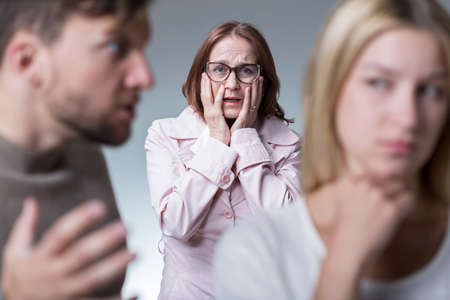family problems: Image of marital quarrel and good protective mother Stock Photo