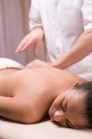 physiotherapists: Woman with back pine on massage at physiotherapists office Stock Photo