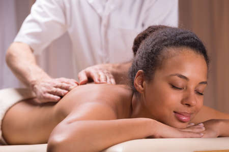 regeneration: Relaxed young woman and regeneration on massage in spa