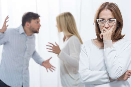 motherly: Picture of marital quarrel and worried psychologist