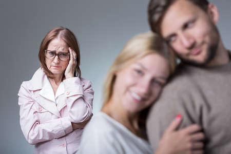 intrusive: Image of couple in love and overprotective envy mother