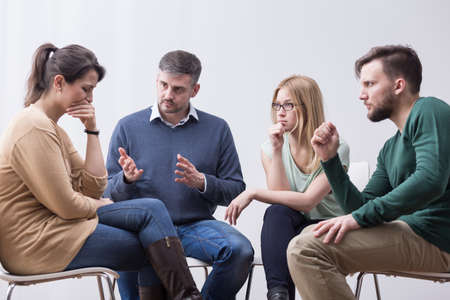 circle of friends: People are helping their friend during group therapy