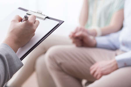 therapy group: Therapist is talking with a couple about their problems Stock Photo