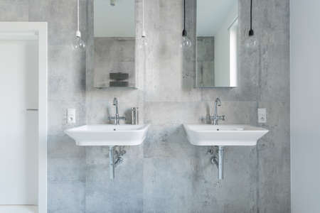 washbasins: Two expensive washbasins in modern and light bathroom