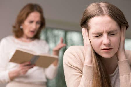 fear woman: Teenage worried girl having problems at school Stock Photo