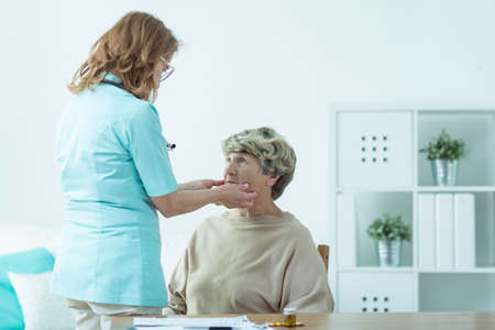 examined: Disabled senior lady examined by a doctor in nursing home