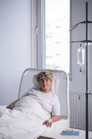 solitude: Elder woman on a drip in hospital