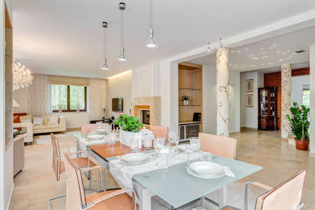 dinning table: Horizontal picture of chic residence prepared for a big party