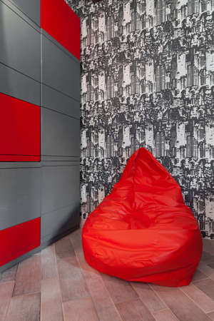 avant garde: Photo of  stylish red pouf ideal for teenage room Stock Photo