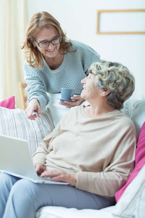 Prefessional carer talking to her elderly patient Stock Photo