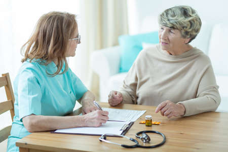 Elderly patient having a medical interview with a doctor