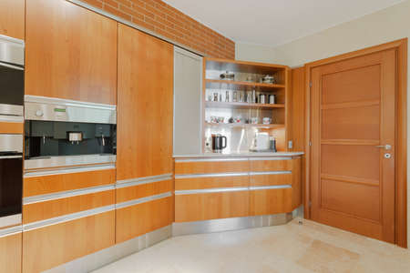 well equipped: Horizontal image of well equipped modern kitchen in wood