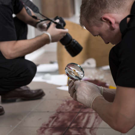 Police officers working at the murder scene