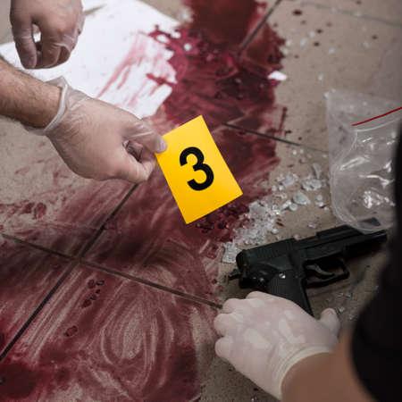investigators: Close-up of investigators collecting evidence of murder