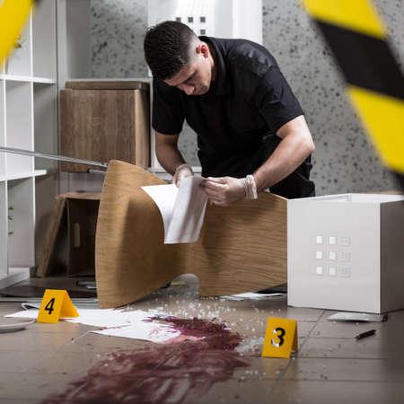 crime scene tape: Police officer found documents at the crime scene