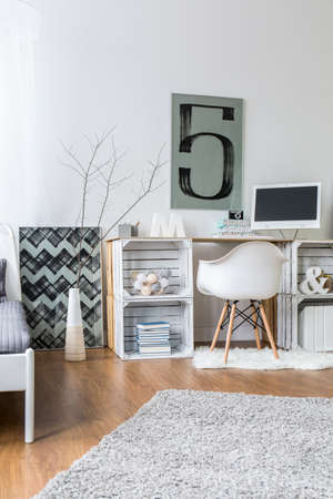 home office: Desk made from chipboard in modern interior