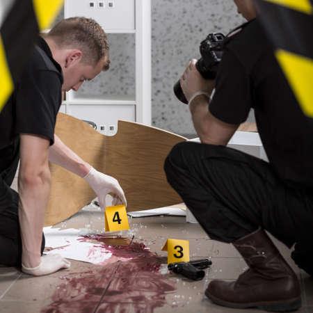 crime scene investigation: Young police officers during crime scene investigation Stock Photo